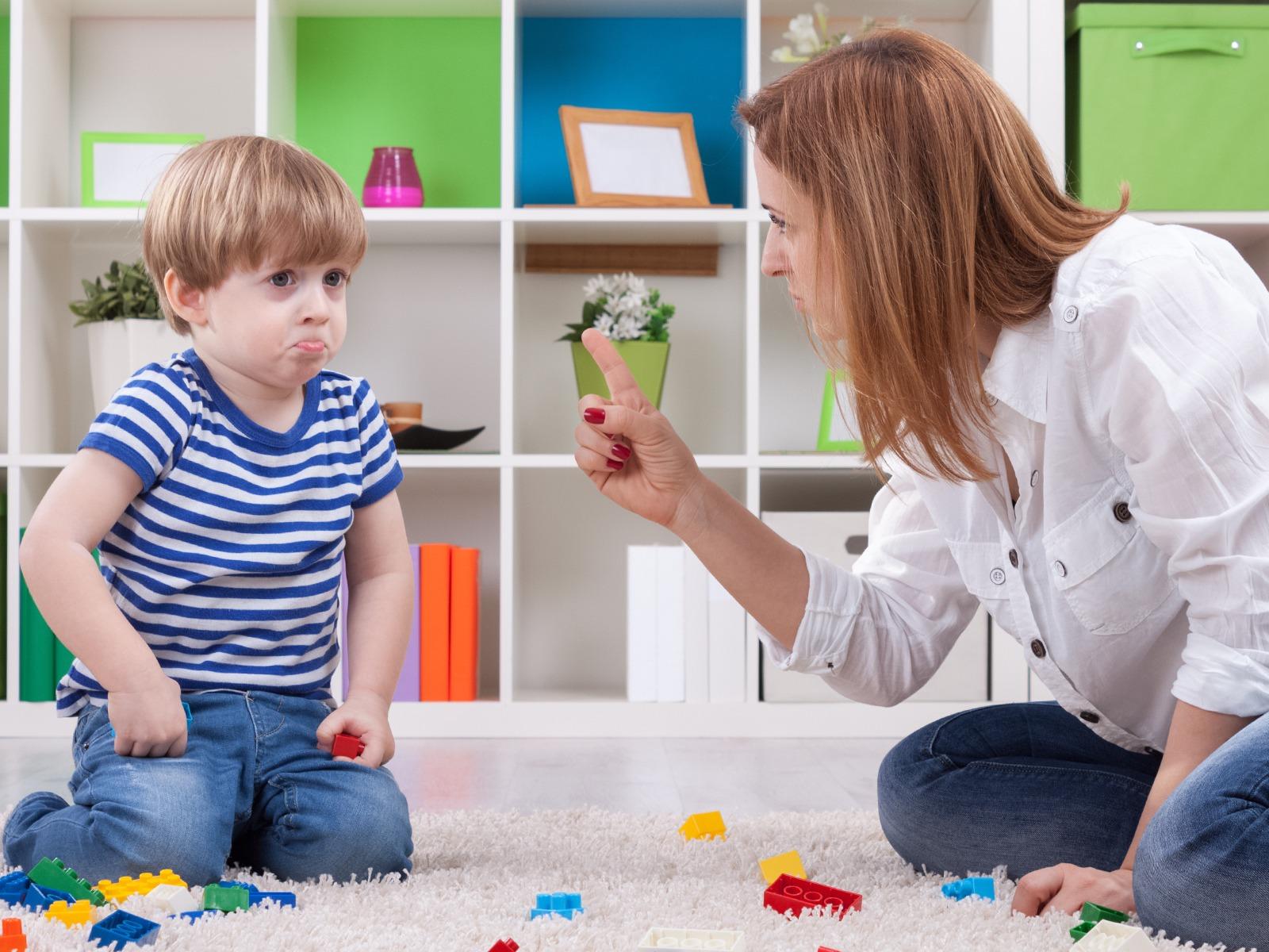 mom disciplining her son